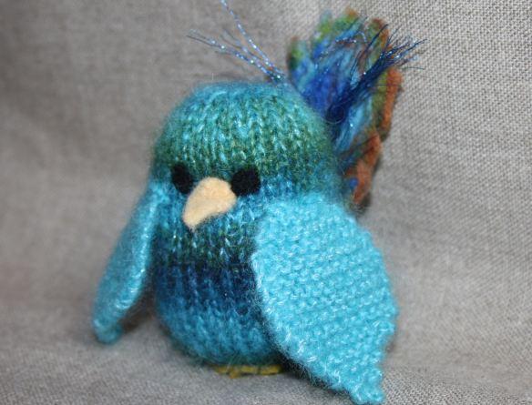 oiseau plume de paon en laine